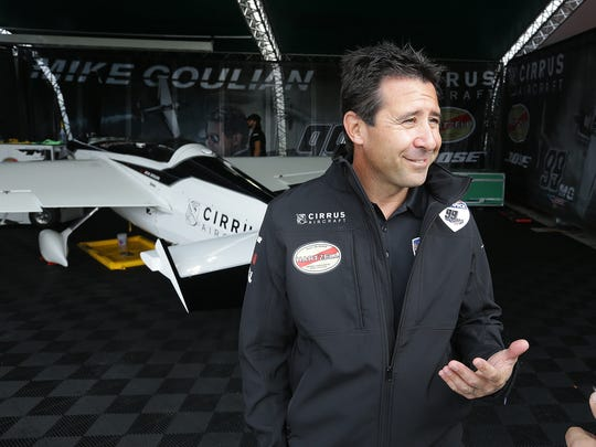 Pilot Michael Goulian, of Team Goulian, talks with