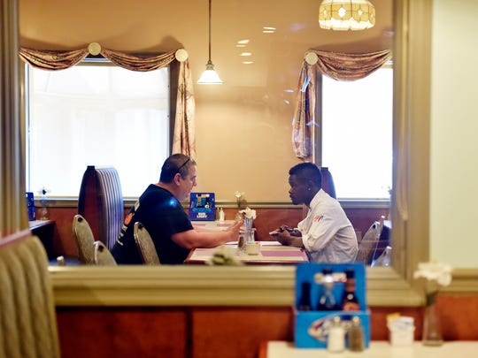 From left, Peach Bottom Inn head chef Jack Lopez sits down with new sous chef Artis Bellamy to review kitchen procedures and schedules Thursday, June 1, 2017. Exelon's Peach Bottom Atomic Power Station nuclear power plant drives much of the surrounding area's economy, especially in the borough of Delta in southeast York County. Lopez said much of the restaurant's business relies on longtime and temporary employees of the Peach Bottom power plant, and that the restaurant and adjoining motel would be adversely affected if the plant were to shut down.