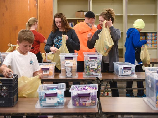 Volunteers pack meals as part of the Rocori Action Packs program March 21 in Cold Spring.