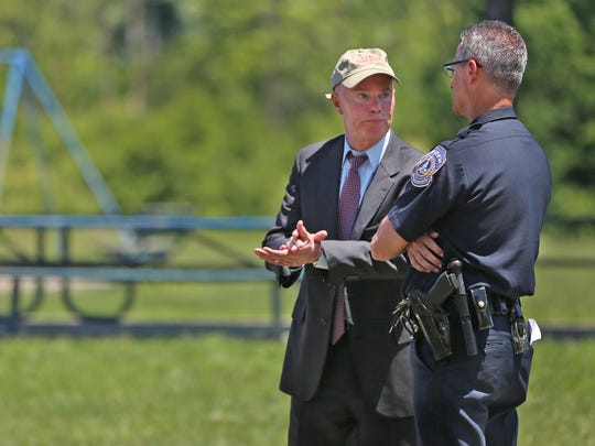 Indianapolis Mayor Joe Hogsett (left) speaks with IMPD Chief Bryan Roach after a press conference in June.