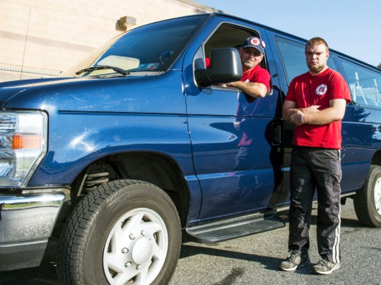 Charles Fuller and Jason Rubnke pose with a Salvation Army vehicle on Wednesday, The two, along with others, will travel to Philadelphia to help with this weekend's visit by Pope Francis. They will be helping to prepare food for emergency workers at the site.