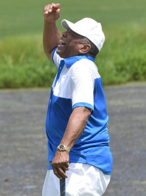 Otis Washington reacts after missing the hole at Oak Wing Golf Club Friday.