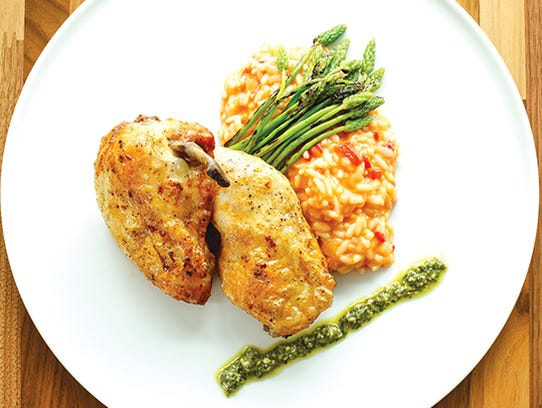 The roasted chicken special over a roasted red pepper