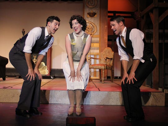"""From left, Sam Balzac as Cosmo Brown, Hannah Eakin as Kathy Selden and Jamey Grisham as Don Lockwood in Barn Theatre's """"Singin' in the Rain."""""""