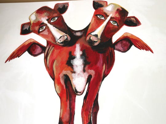 Lisandra di Liberto Brown started painting red cows with wings to symbolize her native home in Hatillo, Puerto Rico and her love for her husband.