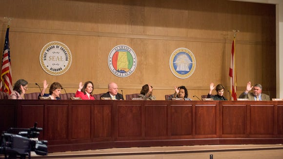 The State Board of Education votes to take over the Montgomery County Schools during their meeting on Thursday February 9, 2017 in Montgomery, Ala.