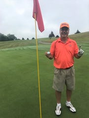 Chris Kallgren celebrates his hole-in-one during the City Senior Golf Tournament at Cedar Creek Golf Club on Tuesday.