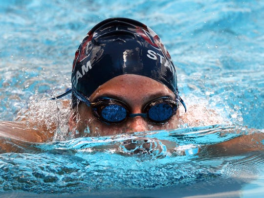 Rachel Weaver of COSST breaks the water as she comes up for a breath in the Girls 200m Breaststroke during the Calumet Specialty Damon McCoy Swim Invitational.