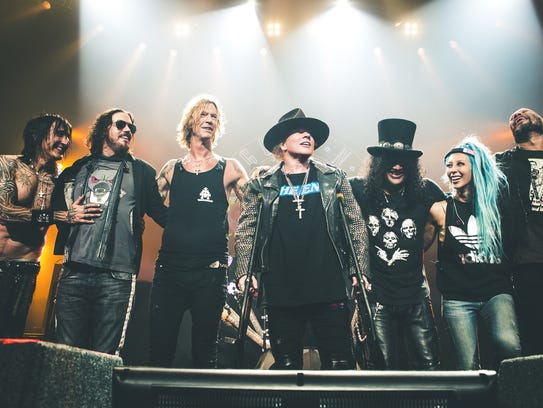 The reunited Guns N' Roses with (center three) Duff