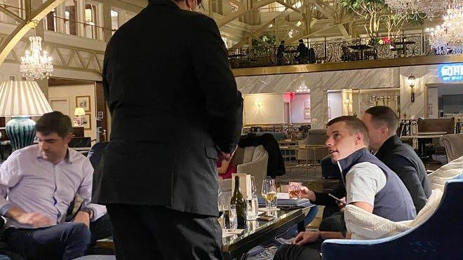 Michigan House Speaker Lee Chatfield, right, and State Rep. Jim Lilly, far left, have drinks at the Trump Hotel in Washington, D.C., on Nov. 20, 2020.