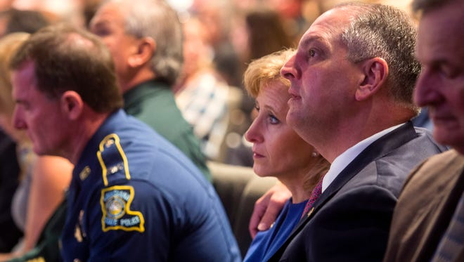 Louisiana Gov. John Bel Edwards and his wife Donna Edwards listen during funeral services for Baton Rouge police officer Matthew Gerald at the Healing Place Church in Baton Rouge, La., Friday, July 22, 2016. Multiple police officers were killed and wounded Sunday morning in a shooting near a gas station in Baton Rouge, less than two weeks after a black man was shot and killed by police here, sparking nightly protests across the city. (Brianna Paciorka/Baton Rouge Advocate via AP, Pool)