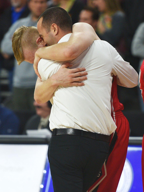 Yankton's Matthew Mors hugs head coach Chris Haynes