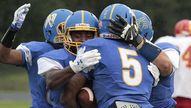 Northwest players celebrate a touchdown during Friday's 41-0 win over North College Hill.