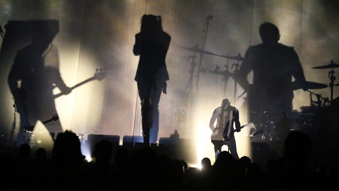 Vocalist Maynard James Keenan, center, and the rest of the rock band A Perfect Circle was backlit during their first song Thursday night in the Don Haskins Center. The West coast group formed in 1999.