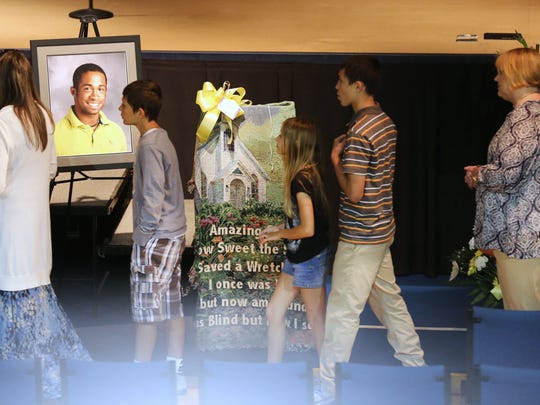 Mourners pay their respect to the family of Travis Dupree Liversgowdy at the Florence Baptist Temple in Burlington. Liversgowdy, 18, was a passenger in an auto crash May 1 on Camp Ernst Road. He died May 7. The car was driven by his friend, Paige Brickler. Brickler and a third teen were also injured in the accident. No charges have yet been filed.