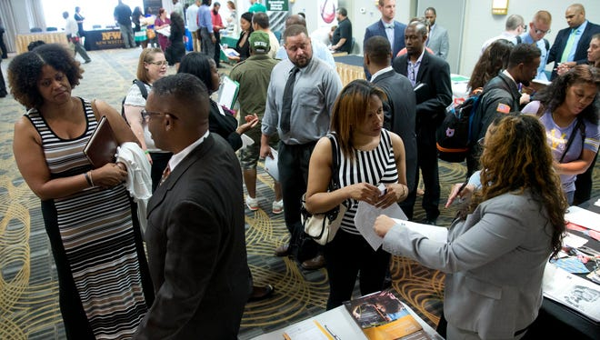 Job seekers and recruiters meet during a job fair in Philadelphia.