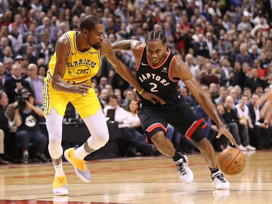 Nov 29, 2018; Toronto, Ontario, CAN; Toronto Raptors forward Kawhi Leonard (2) drives to the basket against Golden State Warriors forward Kevin Durant (35) in the fourth quarter at Scotiabank Arena. The Raptors beat the Warriors 131-128 in overtime. Mandatory Credit: Tom Szczerbowski-USA TODAY Sports