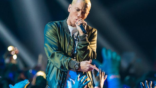 LOS ANGELES, CA - APRIL 13:  Recording artists Eminem performs onstage at the 2014 MTV Movie Awards at Nokia Theatre L.A. Live on April 13, 2014 in Los Angeles, California.  (Photo by Christopher Polk/Getty Images for MTV)