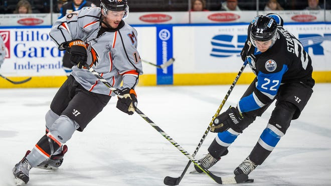 Kansas City Mavericks forward Greg Betzold, left, battles with Wichita's Beau Starrett for the puck in a game last season. Betzold was limited to just 11 games last season because of an upper body injury. The Mavericks have signed Betzold for his fourth season with the ECHL team.
