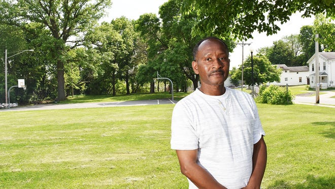 In this May 2018 file photo, Patrick Johnson stands in the park at the corner of South and Steuben in Utica. Johnson is one of 18-members of the City of Utica's police reform advisory committee.