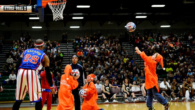 Kids from the audience take part in a shooting competition during the Harlem Globetrotters 2014 Fans Rule World Tour exhibition.