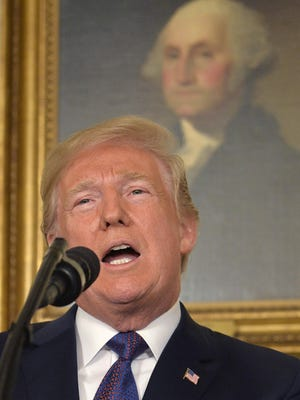 """Donald Trump speaks to the nation, announcing military action against Syria on April 13, 2018, in Washington, DC. Trump on Saturday declared """"Mission Accomplished"""" but the Pentagon said the pummeling of three chemical-related facilities left enough others intact to enable the Assad government to use banned weapons against civilians if it chooses."""