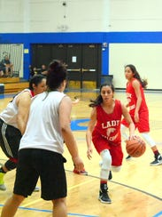 Loving's Alyssa Carrasco looks to pass the ball out
