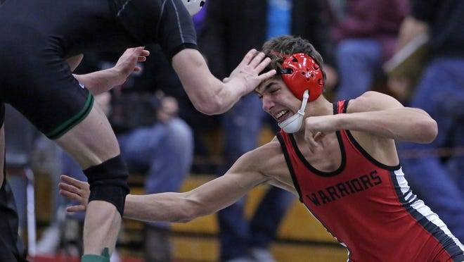 Jacob Megois (right) from Thompson High School in Alabama wrestles in the 138-pound weight class during the Cheesehead Invitational on Friday.
