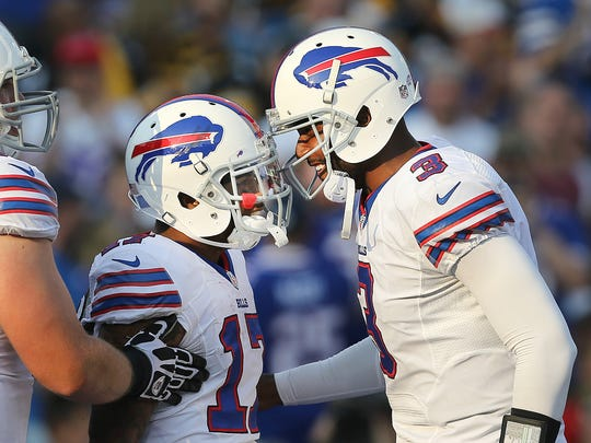 Bills quarterback EJ Manuel celebrates his 37-yard touchdown pass to Tobias Palmer (17) in a 43-19 win over Pittsburgh