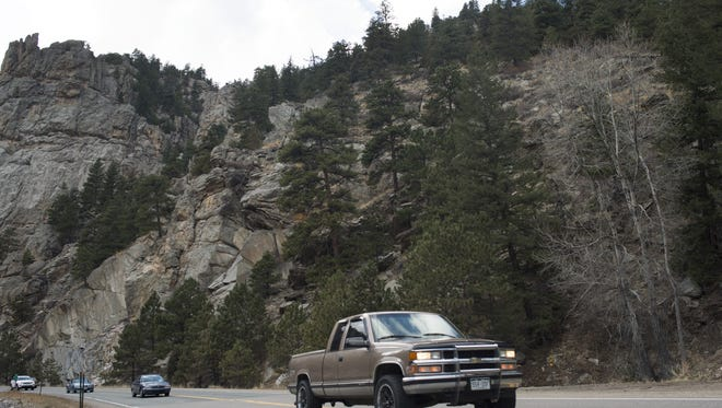 Traffic flows down Big Thompson Canyon on U.S. Highway 34. The road will be closed for nine months beginning Oct. 17.
