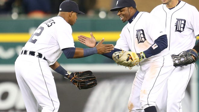 Tigers outfielders Yoenis Cespedes, Raji Davis and J.D. Martinez celebrate the 2-1 win over the New York Yankees on Monday.