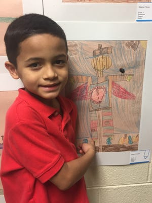 Artist Alfredo Alvarado, a Durand first-grader, shows off his entry in the 20th Annual District-wide Art Exhibit for elementary schools held March 28 at D'Ippolito Elementary School.