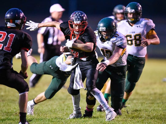 Rocori's Gunner Feldhedge carries the ball near the goal line during the first half of the Friday, Sept. 16, game against Sauk Rapids in Cold Spring.