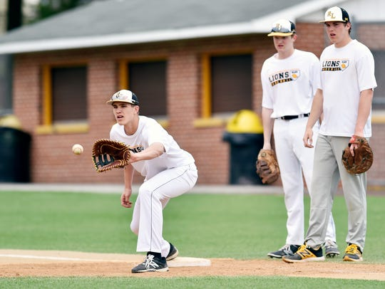 Tyler Burchett, a 6-foot-5 right hander, pitches and