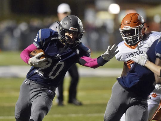 Dallastown's Max Teyral carries the ball for a touchdown against Central York in the first half of a YAIAA football game last season.