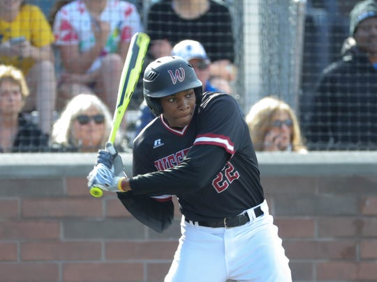 Detroit Western center fielder William English bats