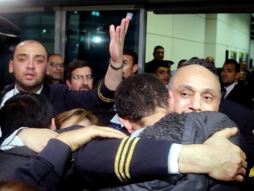 Pilot Captain Amr al-Jamal hugs a passenger of an EgyptAir
