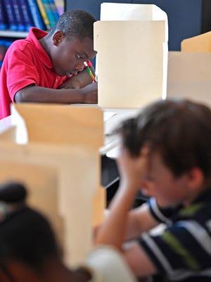 Cortez Murphy takes a test in Amqui Elementary School teacher Jennifer Figueredo's classroom on Tuesday May 16, 2017, in Nashville, Tenn.