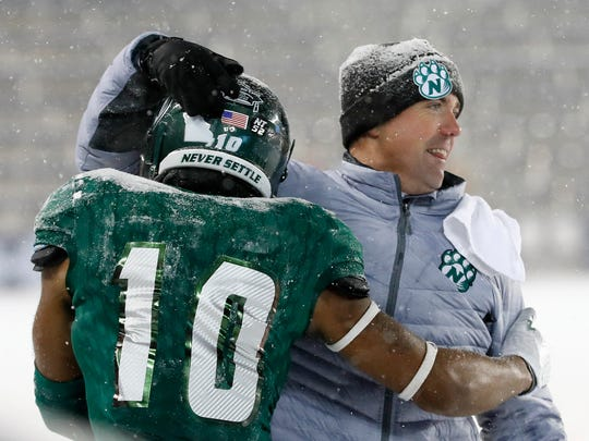 Northwest Missouri State's Emanuel Jones (10) celebrates with head coach Adam Dorrel in the final seconds of the NCAA Division II championship game, Saturday, Dec. 17, 2016, in Kansas City, Kan. Northwest beat North Alabama 29-3. Two days later, Dorrel was introduced as Abilene Christian's new head football coach.