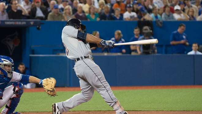 Detroit Tigers center fielder Anthony Gose (12) hits a two run home run during the seventh inning against the Toronto Blue Jays at Rogers Centre. The Blue Jays won 5-3.
