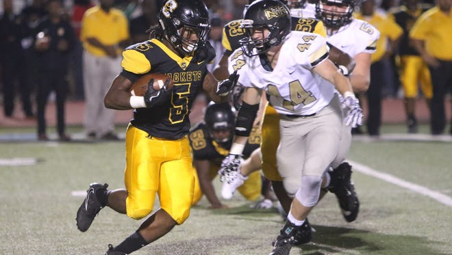 Starkville High School running back Adreus Swanigan looks up field as Northwest Rankin defender Harrison Tharpe closes in for the tackle.