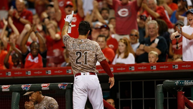 Cincinnati Reds' Michael Lorenzen, 21, takes an encore wave to the crowd after hitting his first career home run, off Los Angeles Dodgers relief pitcher Pedro Baez during the seventh inning of a baseball game, Friday, Aug. 19, 2016, in Cincinnati.