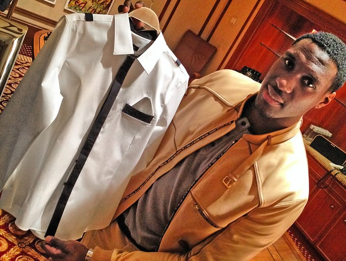 Ian Mahinmi held a private sale Monday evening at the Conrad of his line of high end men's fashion designs, named French Deal. He along with designer Steeven Kodjia set up shop at the posh downtown hotel to let customers see their line of custom made clothes. All handmade in Paris.