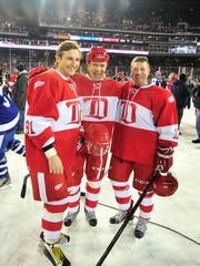 From left, Sergei Fedorov, Slava Fetisov and Doug Brown pose for pictures during a Red Wings alumni game at Comerica Park in December 2013.