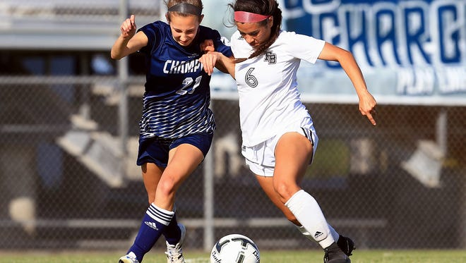 Flour Bluff's Mia Garcia dribbles the ball against Boerne Champion's Ashely Walbrick during the Region IV-5A semifinals Friday, April 7, 2017, at Cabaniss Soccer Field in Corpus Christi.