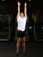 "Personal trainer Brittany Blong of Aspen Athletic demonstrates a jump squat. ""This squat is great for developing powerful legs and putting the finishing touches on a toned backside and legs,"" Kalka said."
