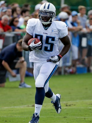 Titans running back Antonio Andrews carries the ball during Monday's practice at Saint Thomas Sports Park.