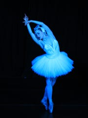 """Chloe Felesina performs as the Swan Queen in the """"Swan Lake"""" for 2014 Brews, Brats and Ballet in Carson City."""