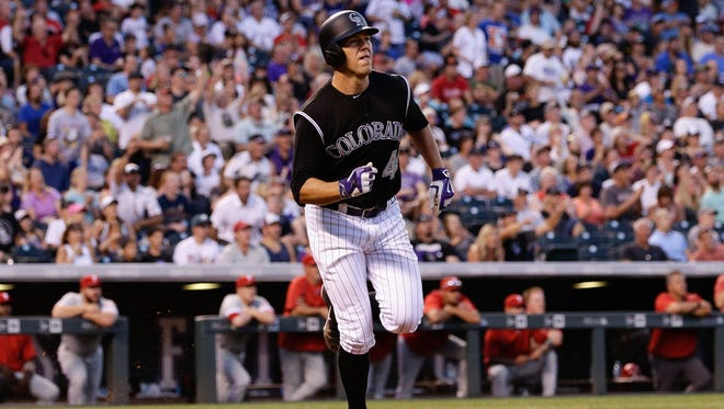 Jul 9, 2016; Denver, CO, USA; Colorado Rockies starting pitcher Tyler Anderson (44) watches his ball after hitting a two run home run in the fifth inning against the Philadelphia Phillies at Coors Field. Mandatory Credit: Isaiah J. Downing-USA TODAY Sports