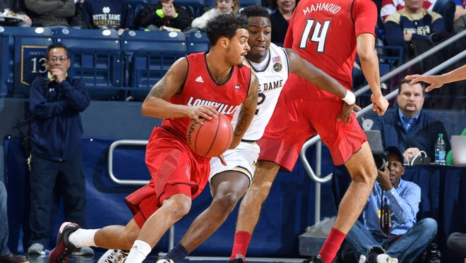 Louisville Cardinals guard Quentin Snider (4) dribbles as Notre Dame Fighting Irish guard T.J. Gibbs (2) defends in the first half at the Purcell Pavilion.